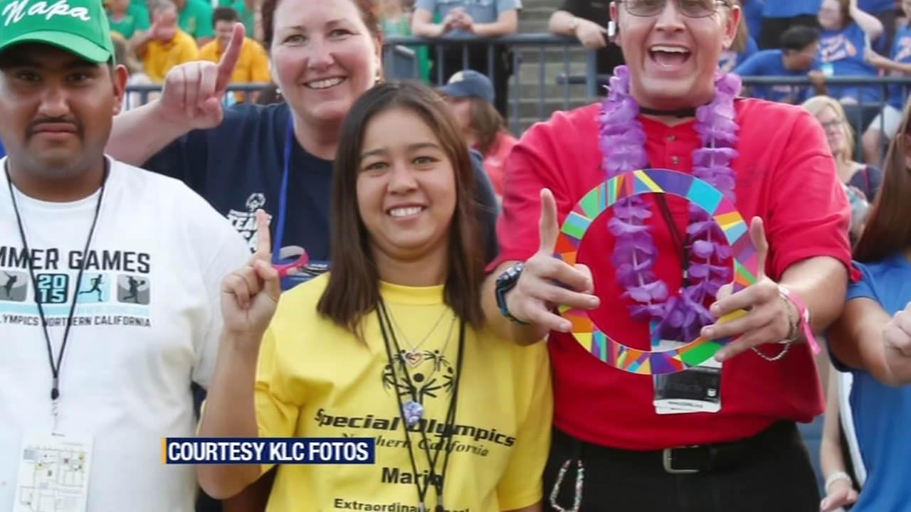 FILE - In this undated image, Sarah Huynh who is taking part in the Special Olympics World Games, poses for a group photo.