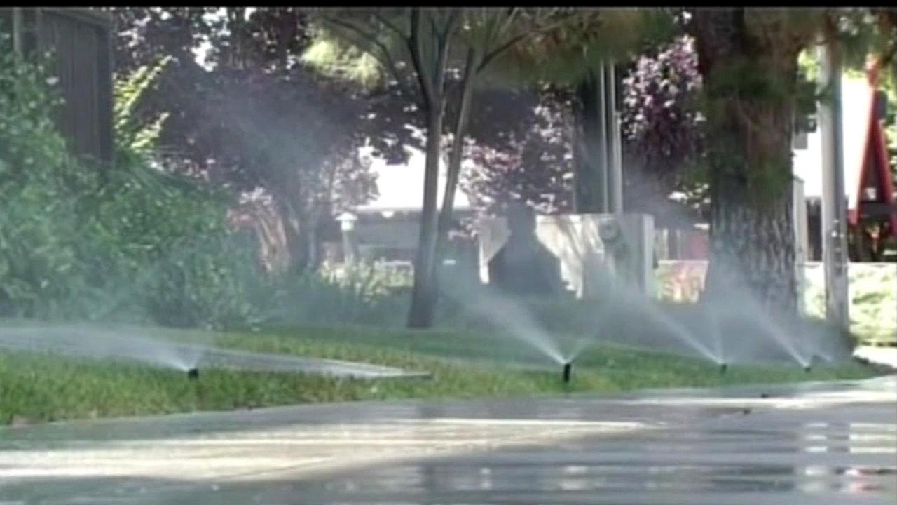 FILE - Water sprinklers are seen in this undated image.