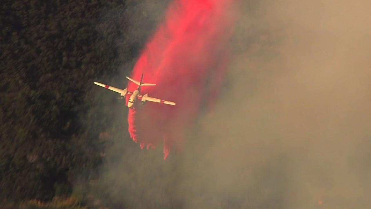 Cal Fire aircraft dropping retardant