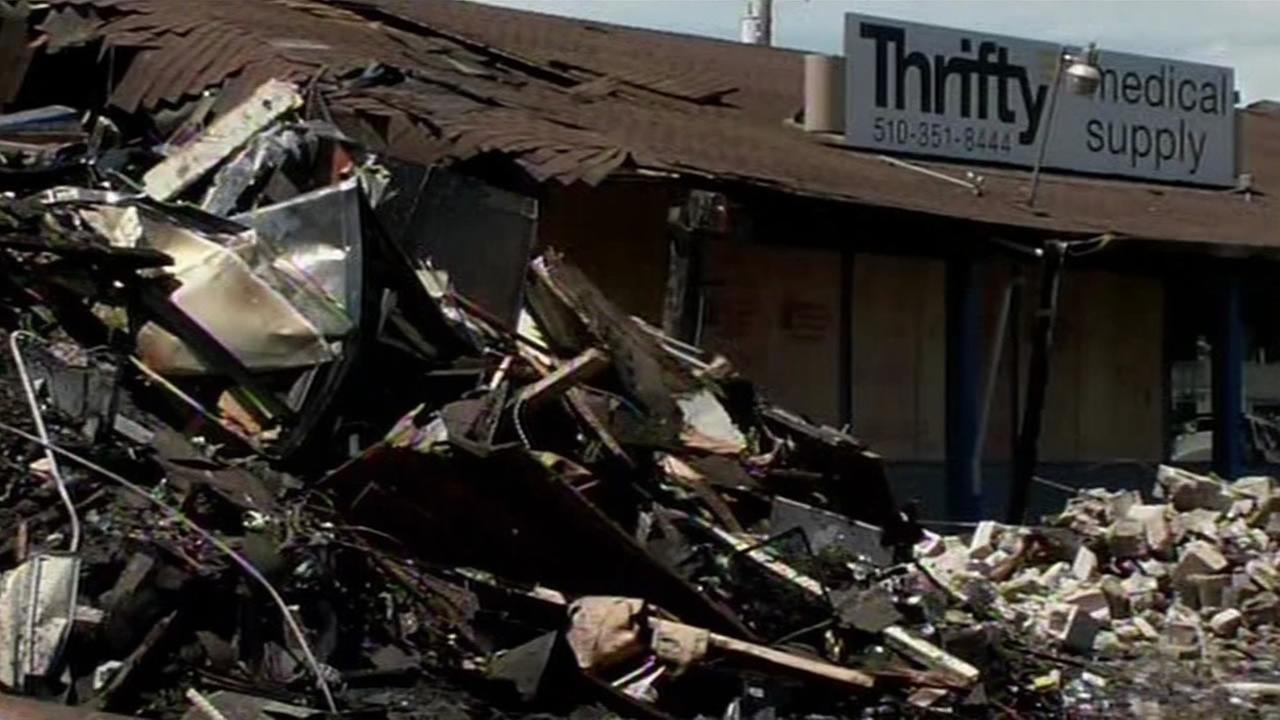 San Leandro officials are investigating the cause of a suspicious fire that destroyed a popular supermarket and caused damaged to several businesses on Monday, August 10, 2015.