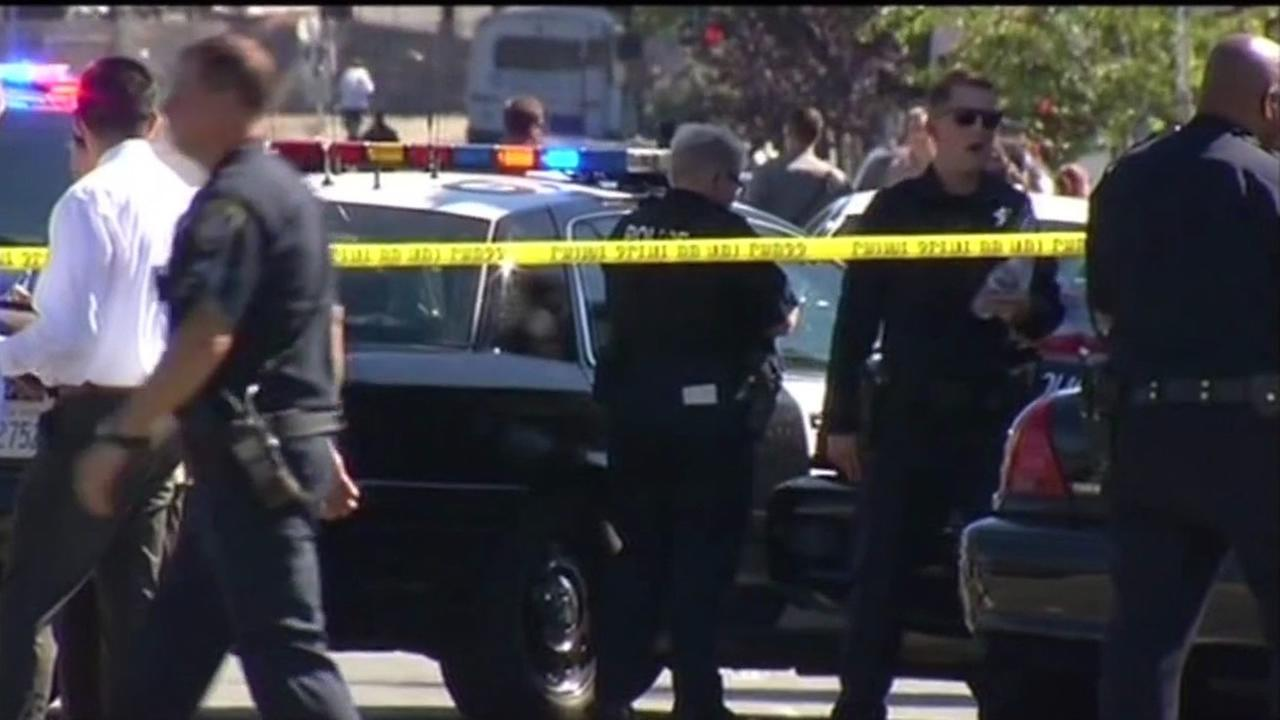Oakland police investigate a fatal officer-involved shooting on 27th street and Martin Luther King Jr. Way on Wednesday, August 12, 2015.