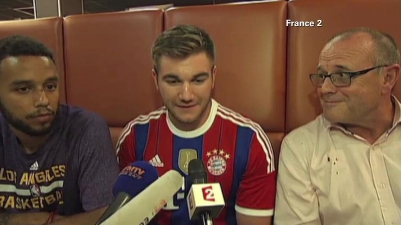 Anthony Sadler, left, and Alek Skarlatos, center, speak out about their role in taking down a gunman in a European train attack, in an interview on Saturday, Aug. 22, 2015.