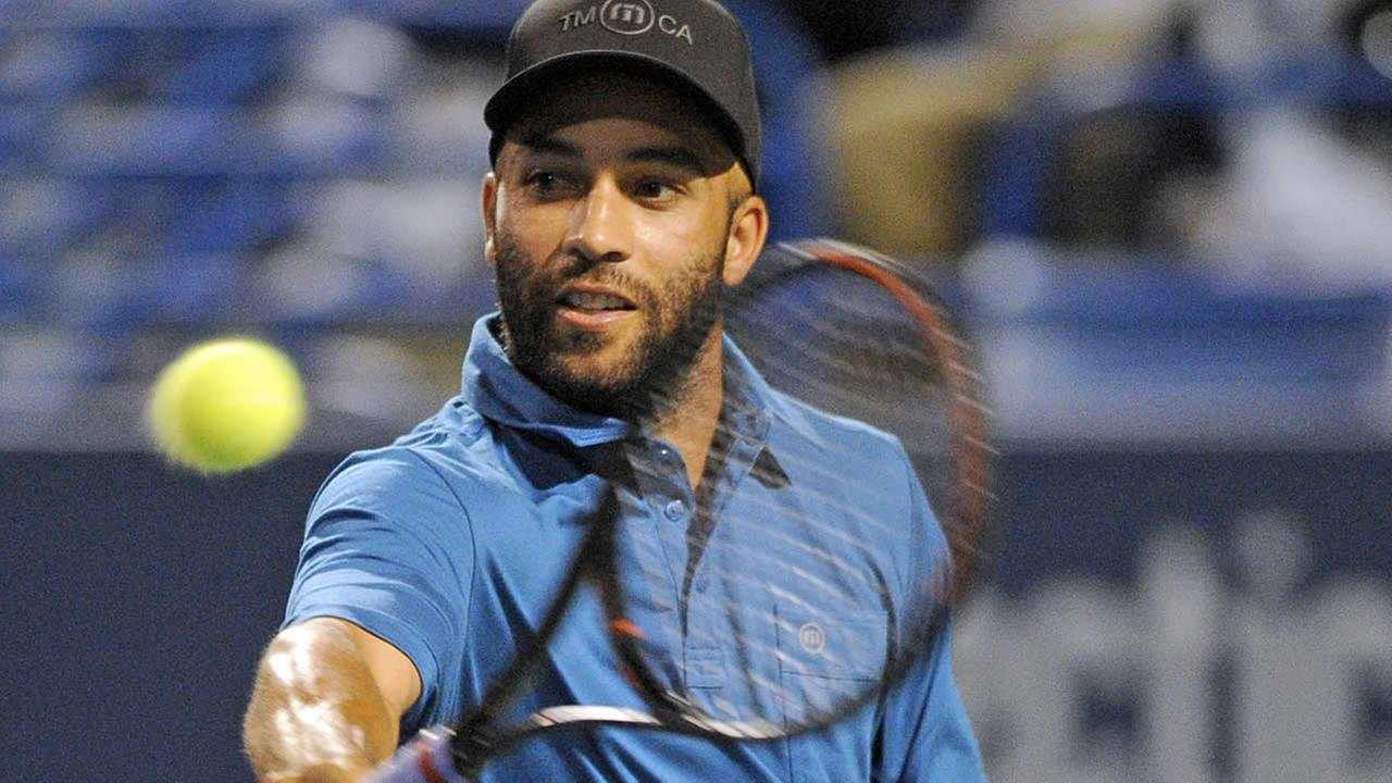 James Blake hits a backhand during his Legends match with Andy Roddick at the New Haven Open tennis tournament in New Haven, Conn., on Thursday, Aug. 21, 2014. (AP Photo)