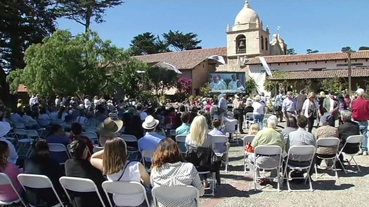 A large crowd gathered outside the Carmel Mission Basilica to watch the historic canonization of Father Junipero Serra on Wednesday, September 23, 2015.
