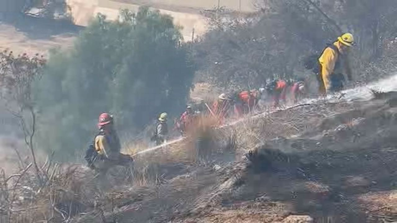 This undated image shows firefighters battling Camp Fire burning in Butte County.