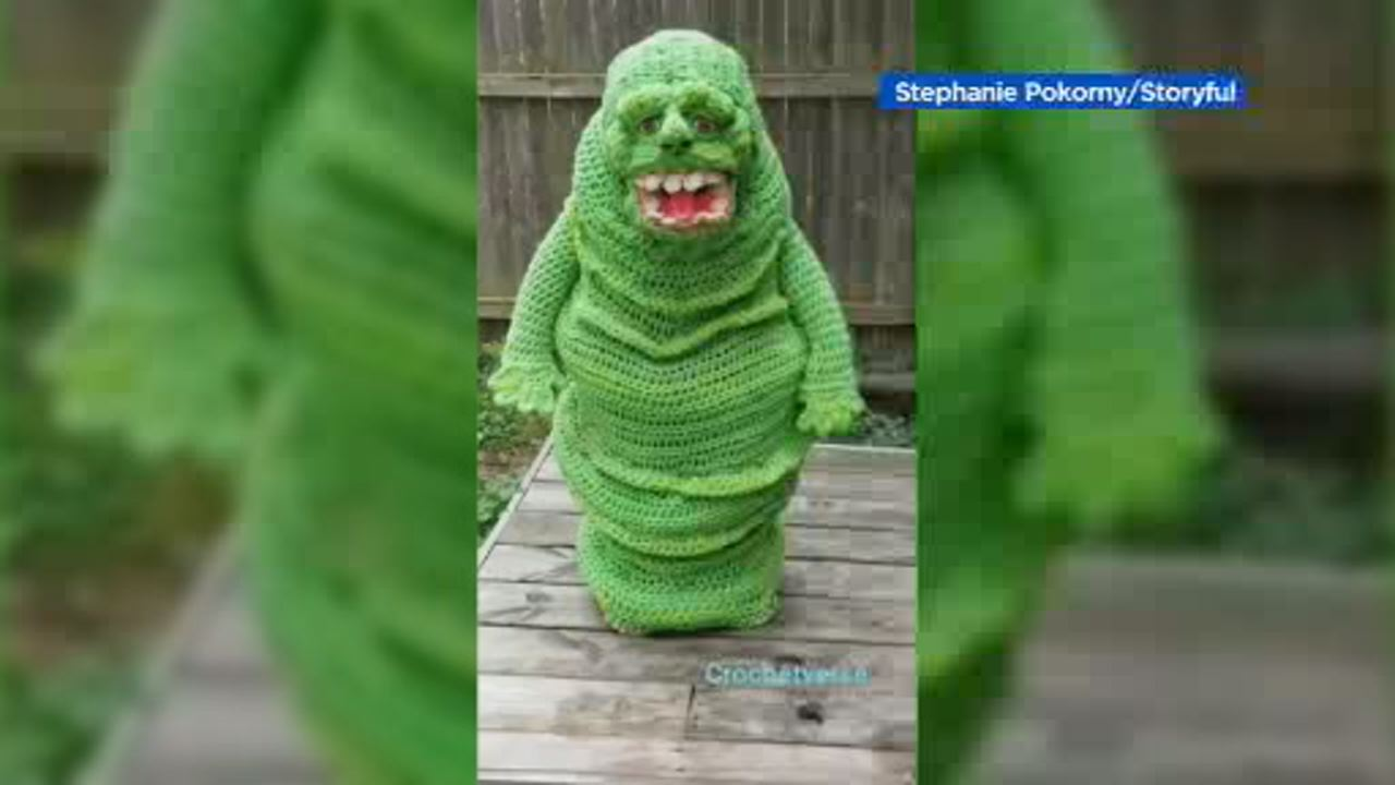 This image shows a boy in Ohio showing off his epic crochet Slimer costume on October 15.