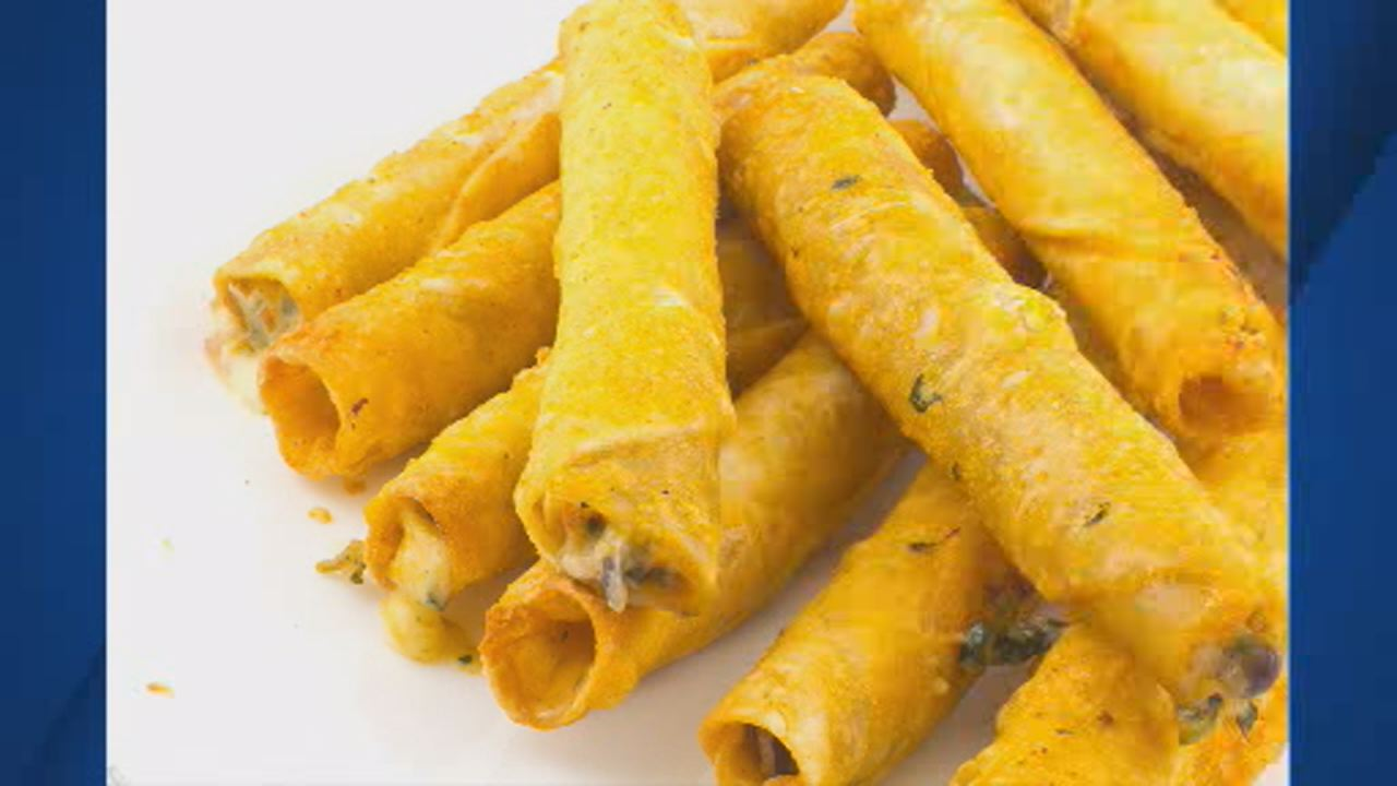This image shows a large serving of fried taquitos.