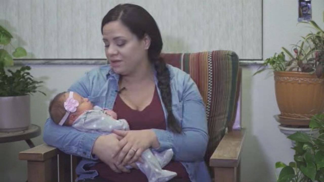 Heather Roebuck holds her miracle baby after surviving the Camp Fire in Butte County, Calif.