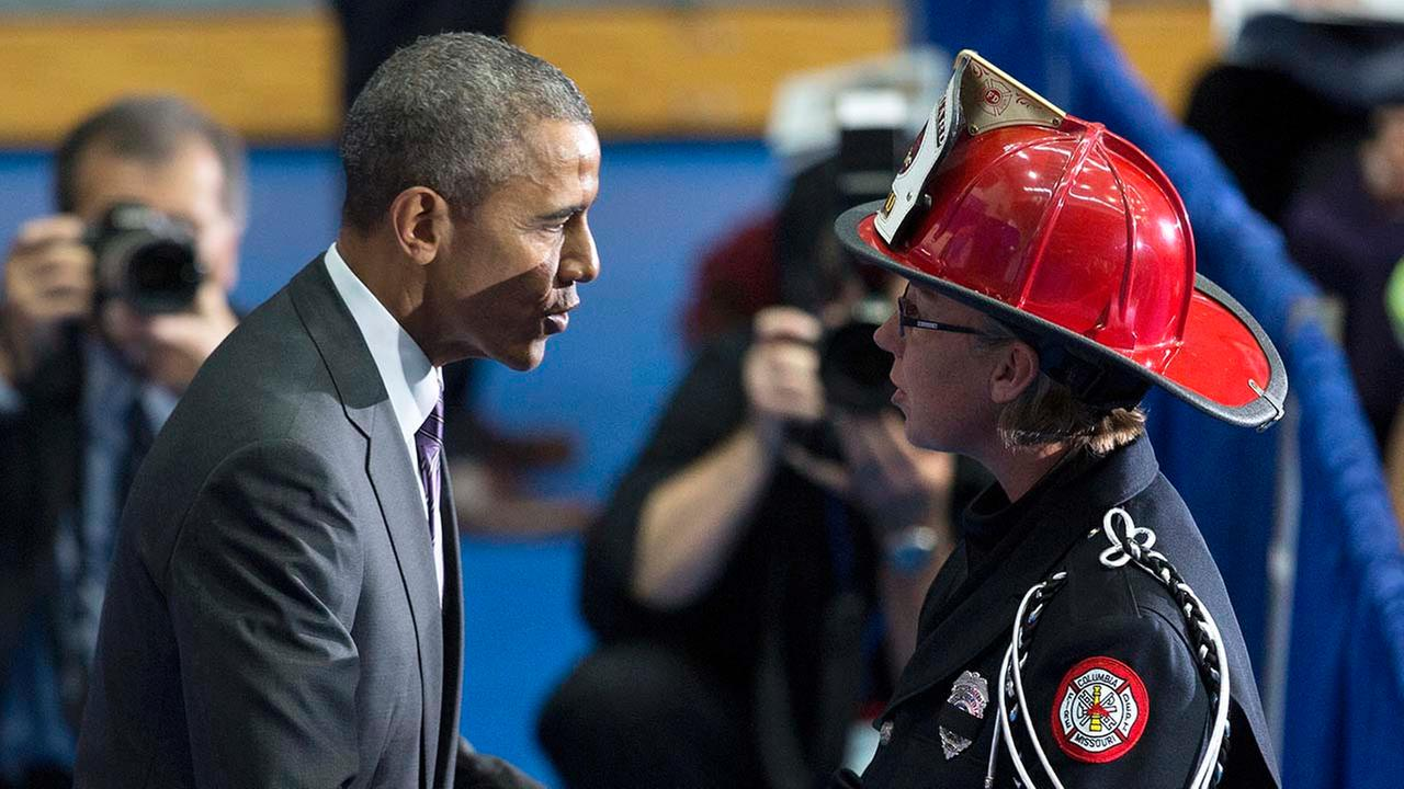 President Barack Obama greets family members and coworkers of fallen firefighters during the National Fallen Firefighters Memorial Service