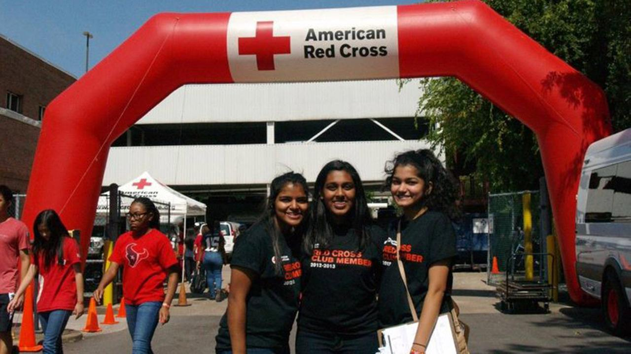 Tonia Malayil (l), Deborah Sunny, and Feba Jacob, student volunteers celebrate the 100 year annivesary of the Houston Area Red Cross on Saturday, Oct. 10.