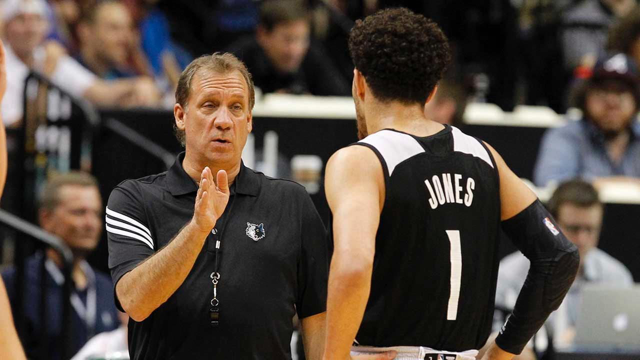 Minnesota Timberwolves head coach Flip Saunders, left, talks with guard Tyus Jones (1) during an NBA basketball scrimmage in Minneapolis, Wednesday, July 8, 2015.