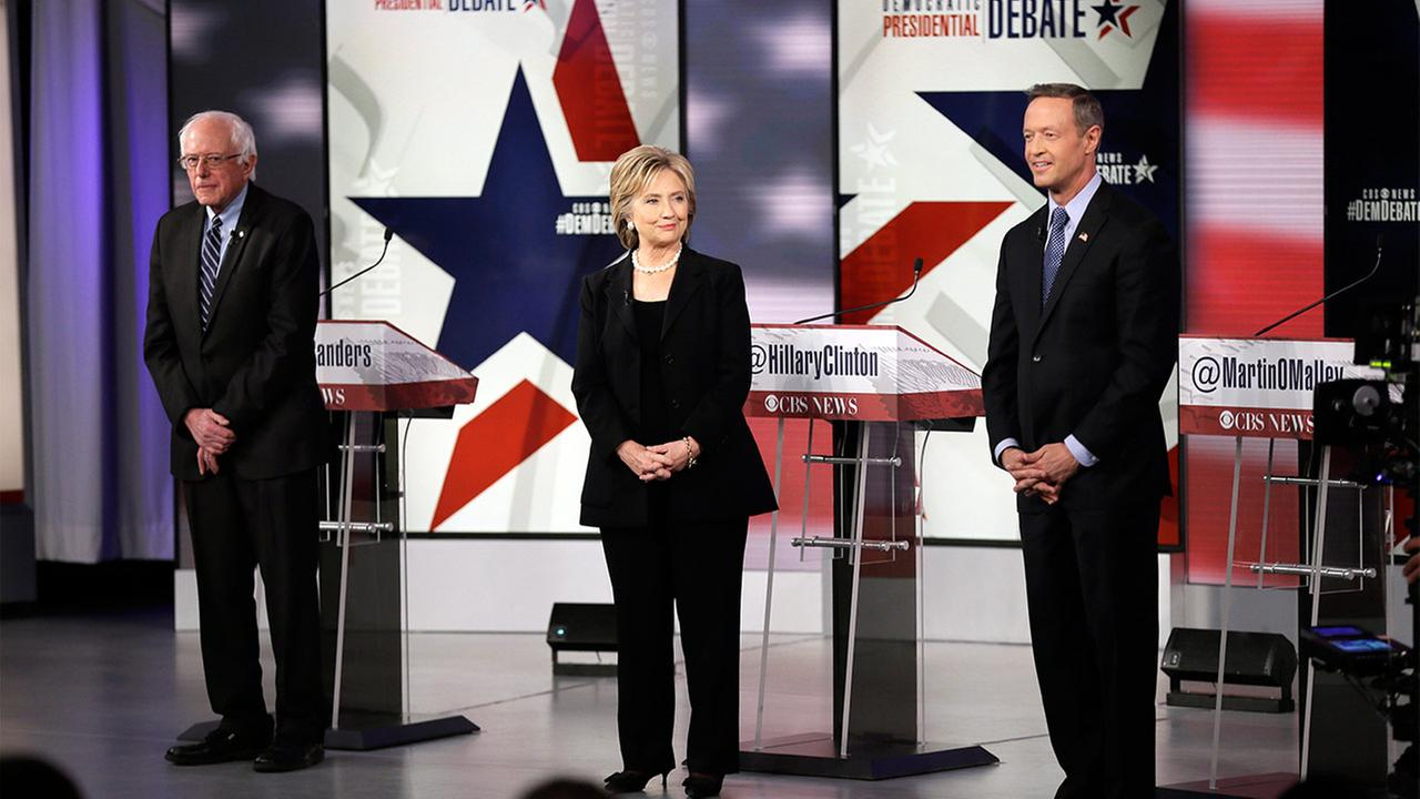 Democratic presidential candidates Bernie Sanders, left, Hillary Rodham Clinton and Martin OMalley appear during a Democratic presidential primary debate.