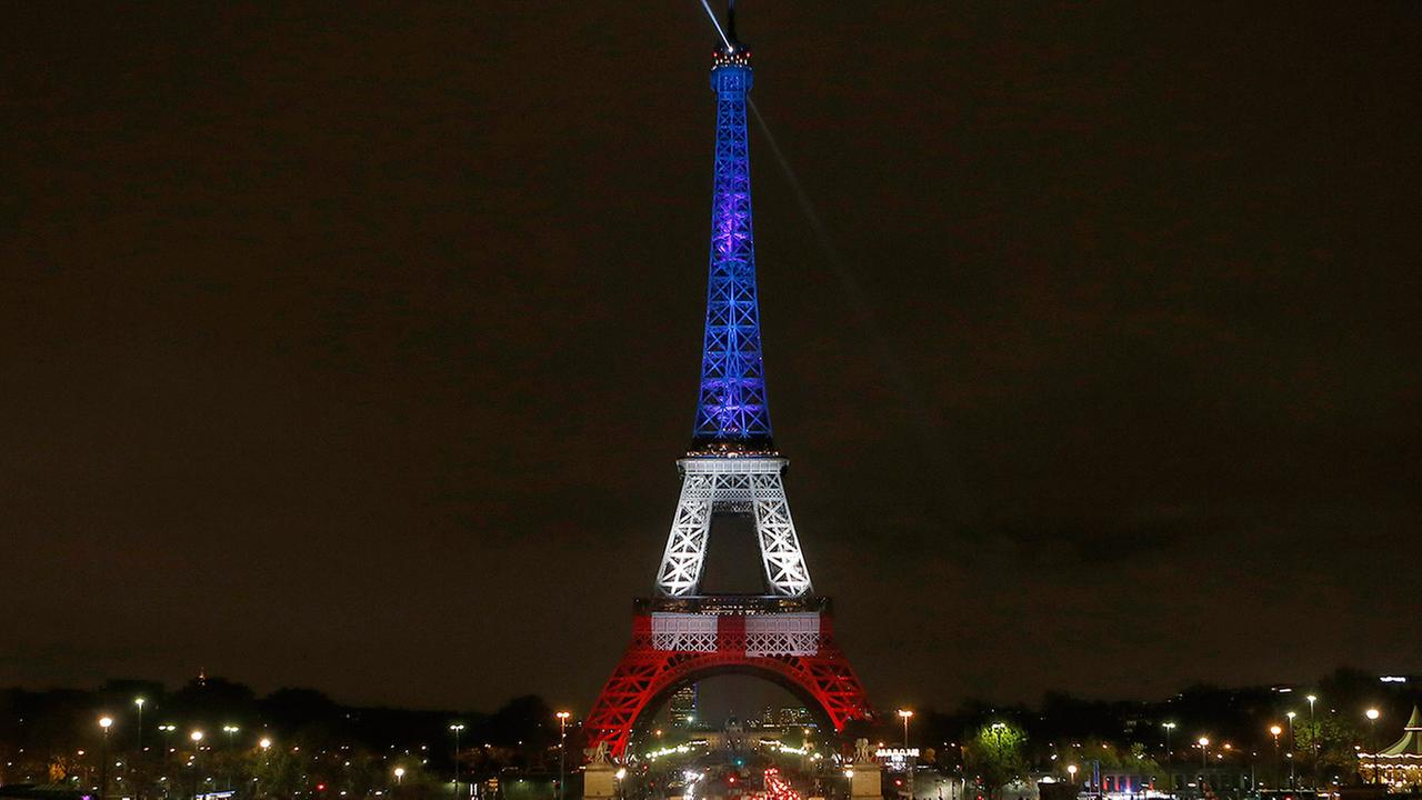 The Eiffel Tower is illuminated in the French national colors red, white and blue in honor of the victims of the terror attacks in Paris -- Monday, Nov. 16, 2015.