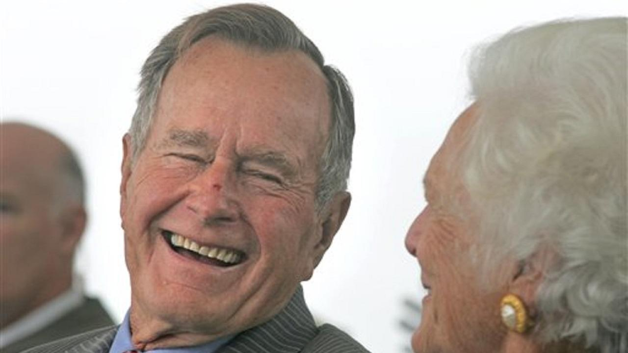 Former president George H.W. Bush smiles at his wife, Barbara.