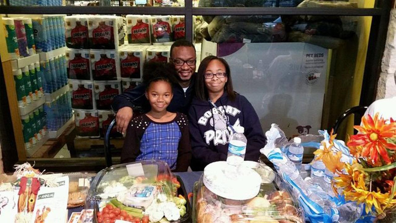 Sammy Davis and his two daughters, Jaylah and Taylor, during the sixth annual Bird Bowl and HAAM food drive at the Atascocita Kroger Tuesday, Nov. 24, 2015.