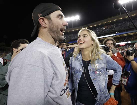 Houston Astros Justin Verlander celebrates with Kate Upton after Game 7 of baseballs World Series against the Los Angeles Dodgers. (AP Photo/Matt Slocum)