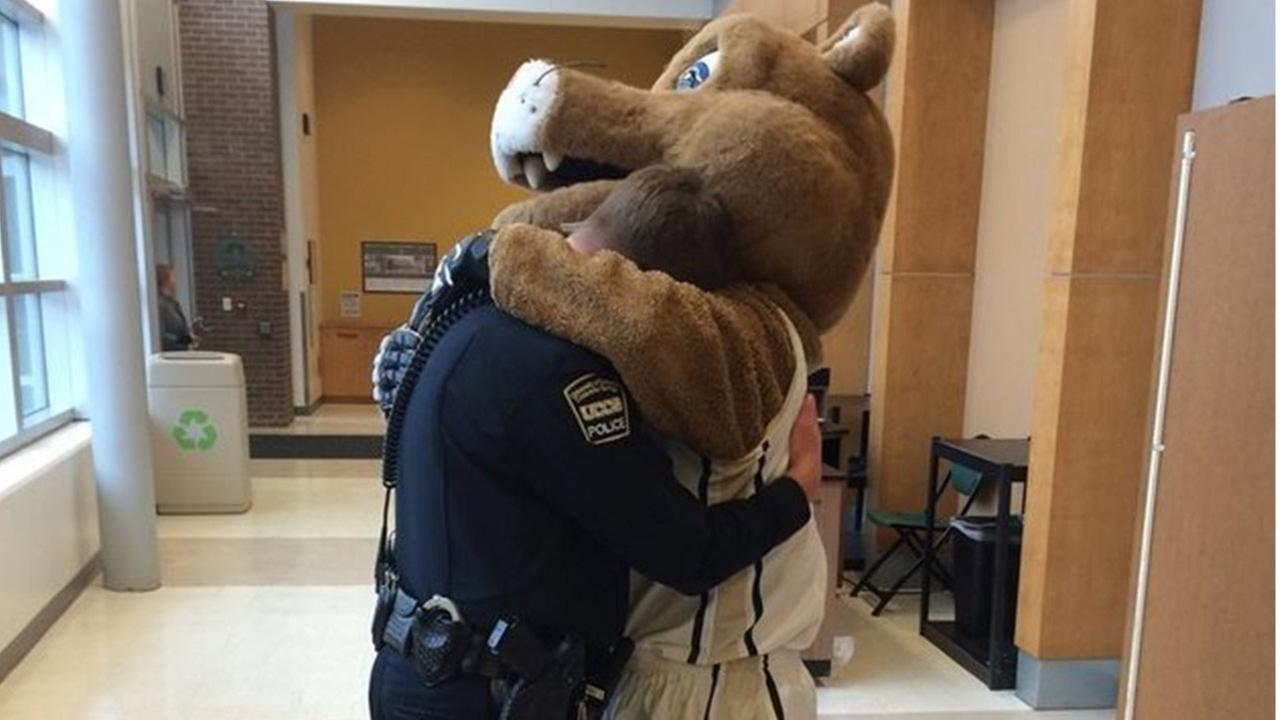 Grieving officer comforted by mascot before game at University of Colorado