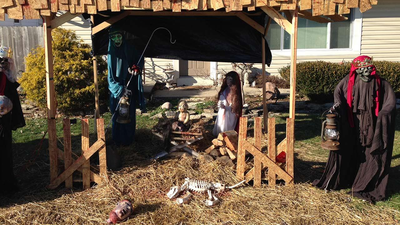 A Zombie Nativity scene stands on the front yard of Jasen Dixons home in Sycamore Township, Ohio, near Cincinnati, Tuesday, Dec. 30, 2014.