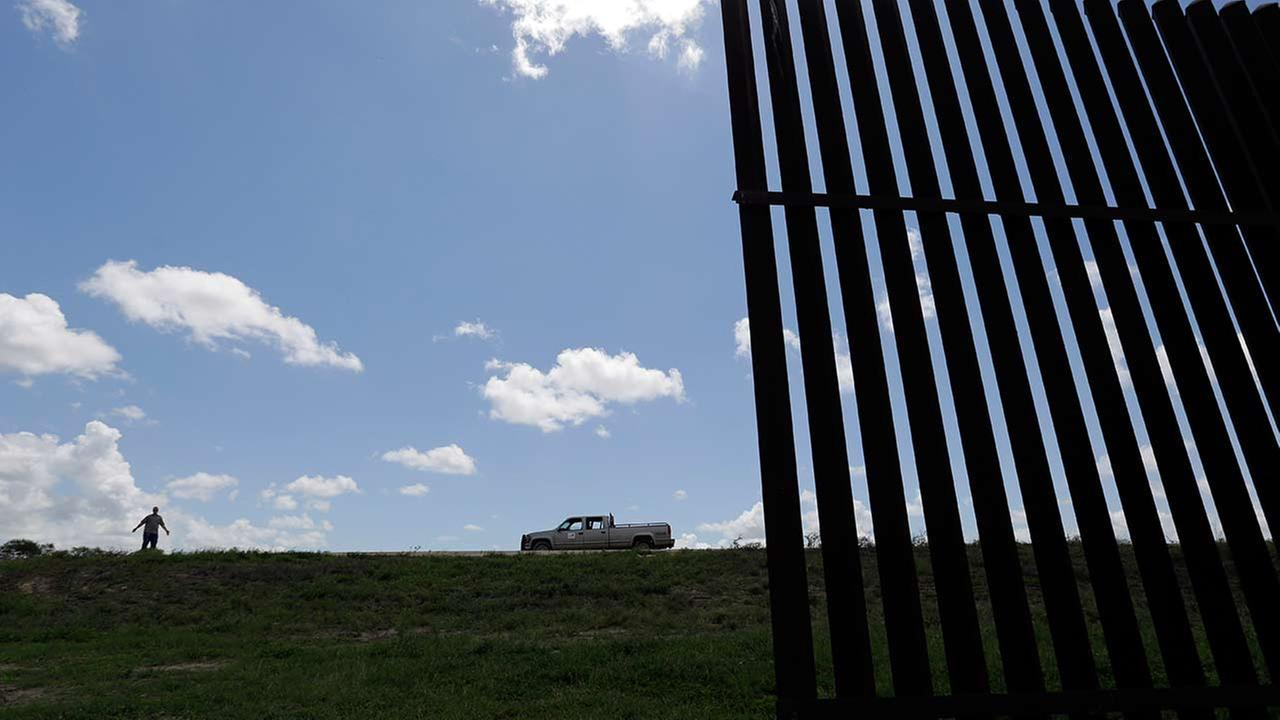 In this Thursday, Sept. 17, 2015, photo, Max Pons stands near the southern end of the border fence, near Brownsville, Texas.
