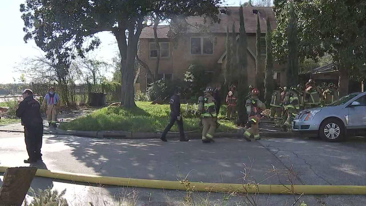 Two people suffer burns in house fire near museum district