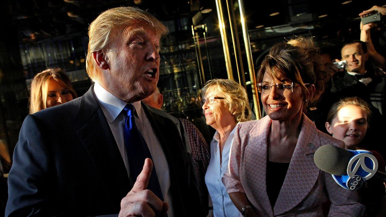 Donald Trump makes a point as he walks with former governor of Alaska Sarah Palin in New York City as they make their way to a scheduled meeting Tuesday, May 31, 2011