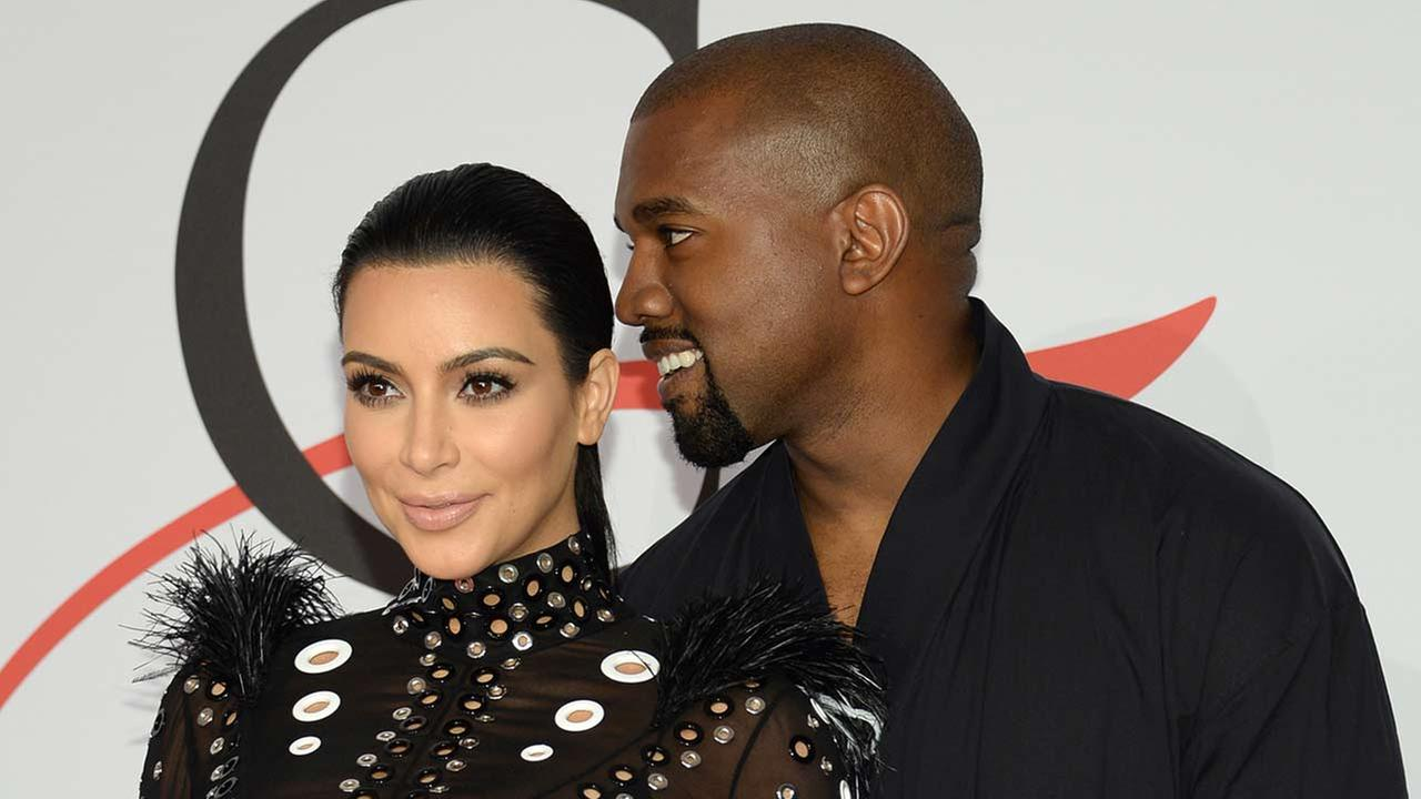 Kim Kardashian, left, and Kanye West arrive at the 2015 CFDA Fashion Awards at Alice Tully Hall, Lincoln Center, in New York.