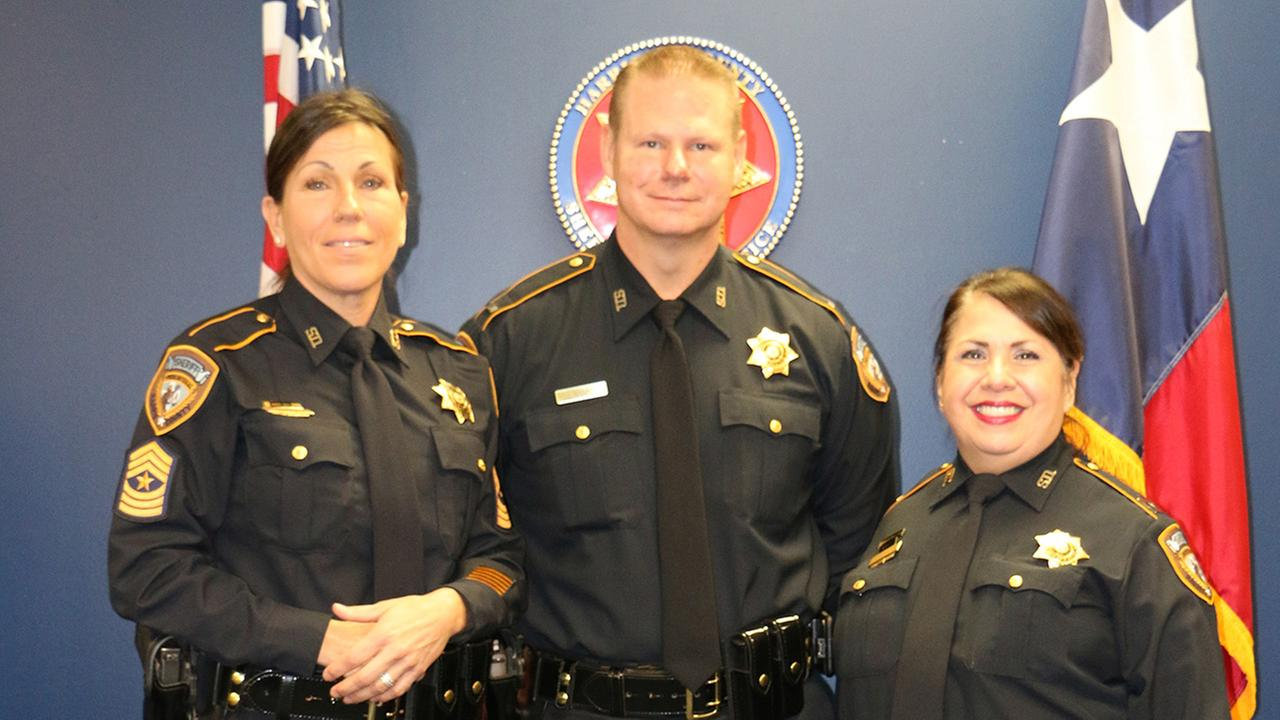 From left: Lt. Margie Ratterman, Capt. John Nanny center and Major Virginia Cavazos-Russell pose together after their promotions at the Harris County Sheriffs Office.