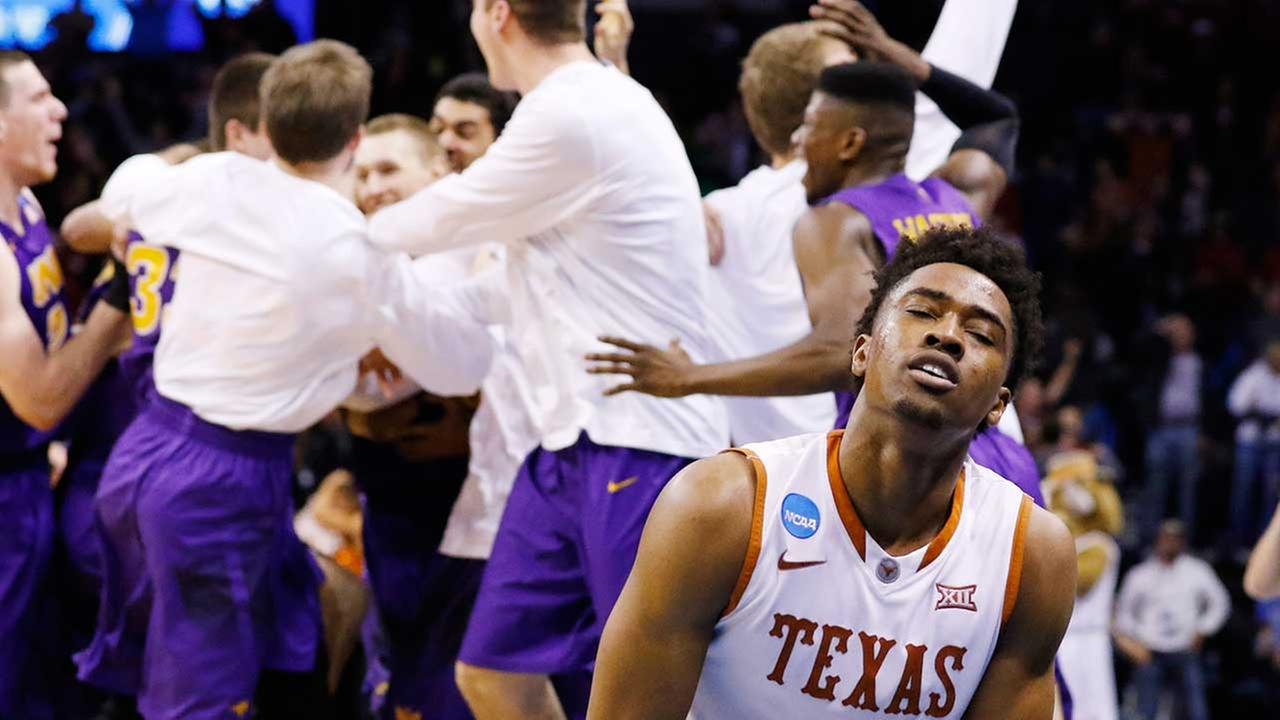 Texas guard Isaiah Taylor (1) reacts as the Northern Iowa team celebrates after Northern Iowa guard Paul Jesperson made a last-second half-court shot