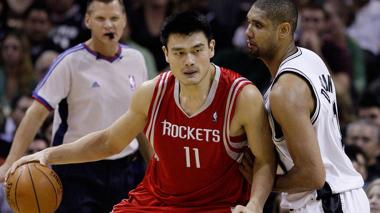 Houston Rockets center Yao Ming (11), of China, is defended by San Antonio Spurs forward Tim Duncan, right, during game in San Antonio, Friday, Nov. 14, 2008.
