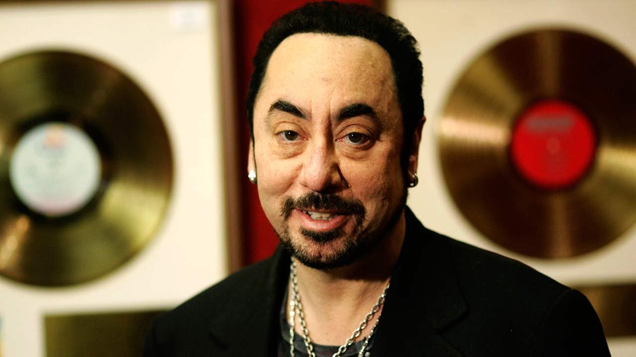 U.S. music producer David Gest poses with some of his collection of entertainment memorabilia at an auction house in London, Wednesday, Nov. 21, 2007.