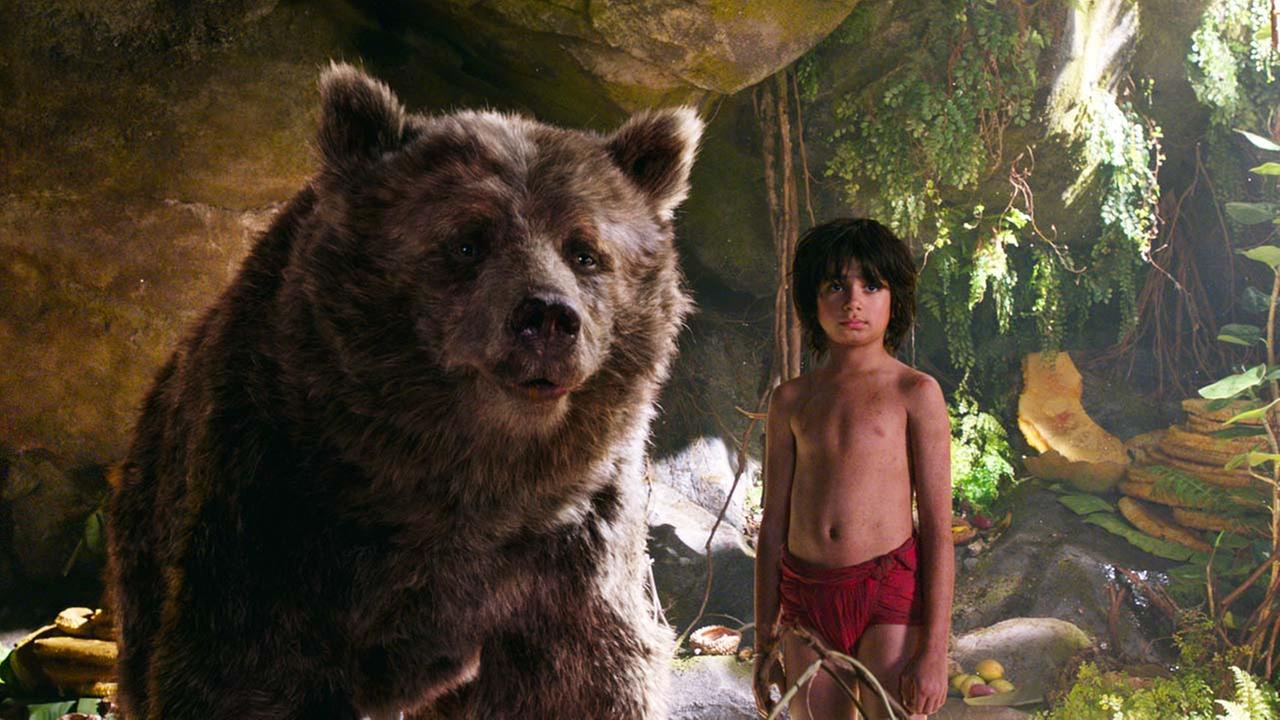 In this image released by Disney, Mowgli, portrayed by Neel Sethi, right, and Baloo the bear, voiced by Bill Murray, appear in a scene from, The Jungle Book.