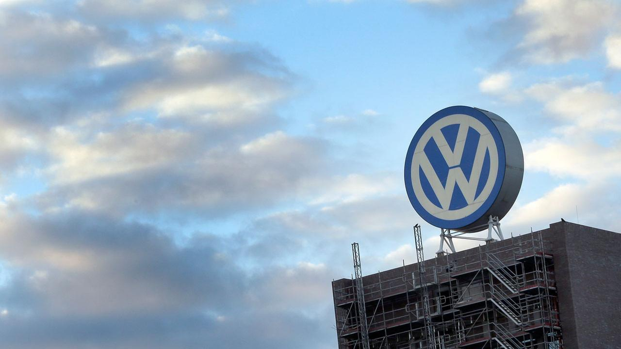 In this Sept. 26, 2015 file photo a giant logo of the German car manufacturer Volkswagen is pictured on top of a companys factory building in Wolfsburg, Germany.