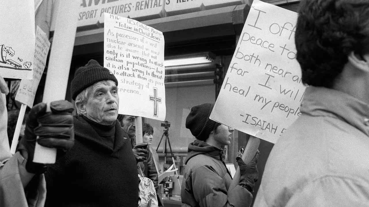 Daniel Berrigan marches with about 40 others outside of the Riverside Research Center in New York on Friday, April 9, 1982, calling for peace and a reduction in nuclear arms.