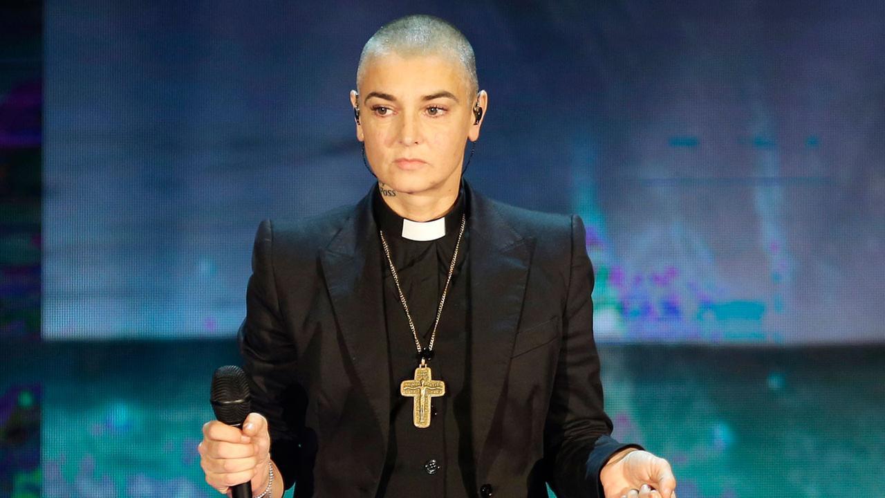 In this Oct. 5, 2014 file photo, Irish singer Sinead OConnor performs during the Italian State RAI TV program Che Tempo che Fa, in Milan, Italy.