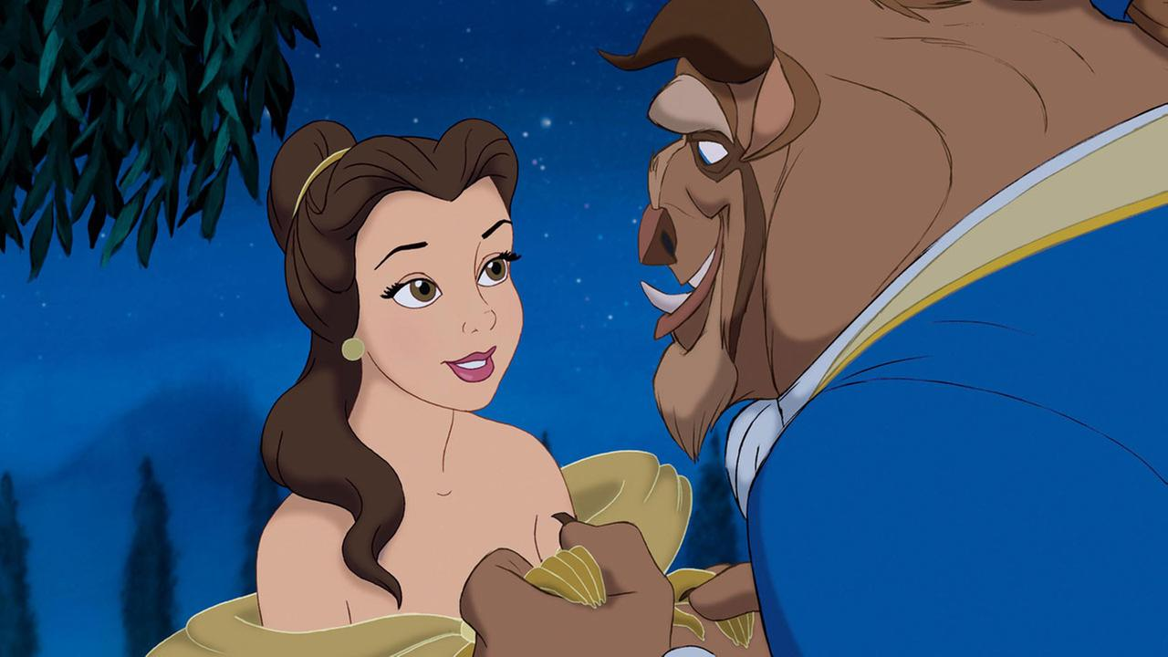 Characters Belle, voiced by Paige OHara, left, and the Beast, voiced by Robby Benson appear in a scene from the animated classic Beauty and the Beast.