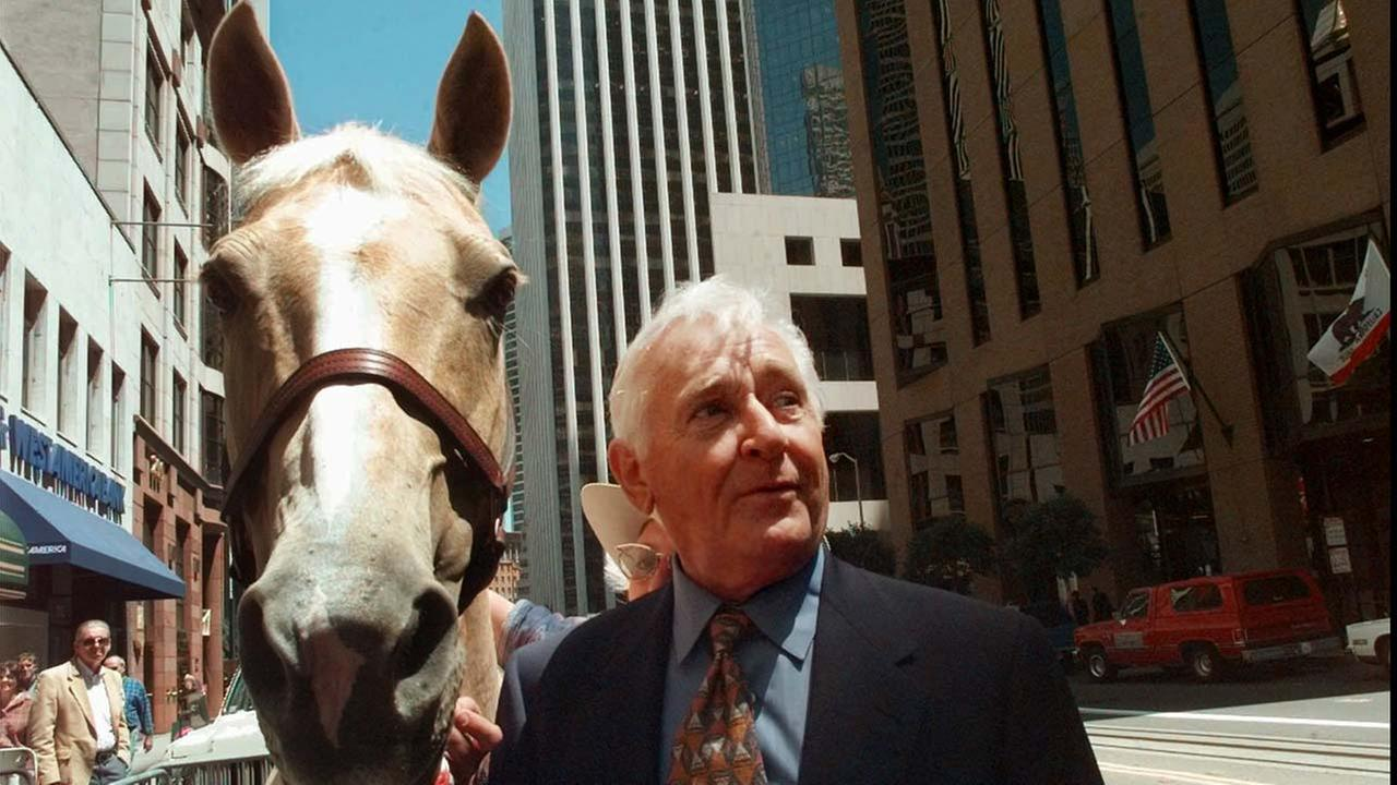 This July 31, 1997, photo shows actor Alan Young of the Mister Ed TV series, with Champagne, a 13-year-old Palomino mare in San Francisco.