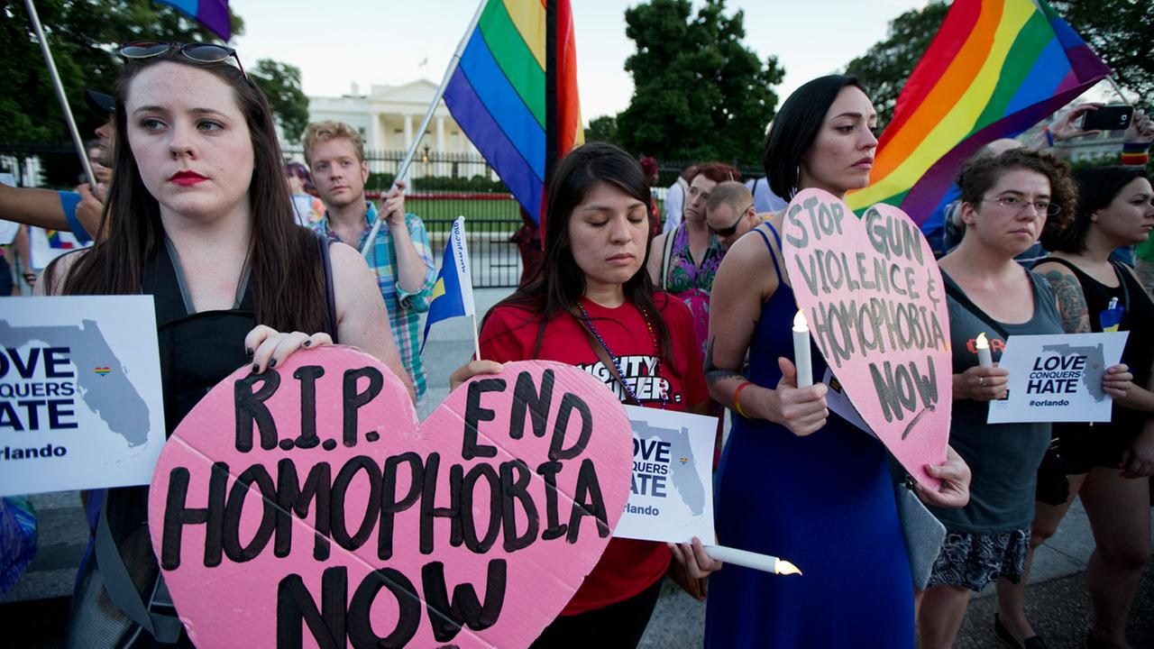 Rachel Henry, from left, Selene Arciga, Nicolette Gullickson and Joanna Lamstein join LGBT supporters as they gather for a candlelight vigil in front of the White House.