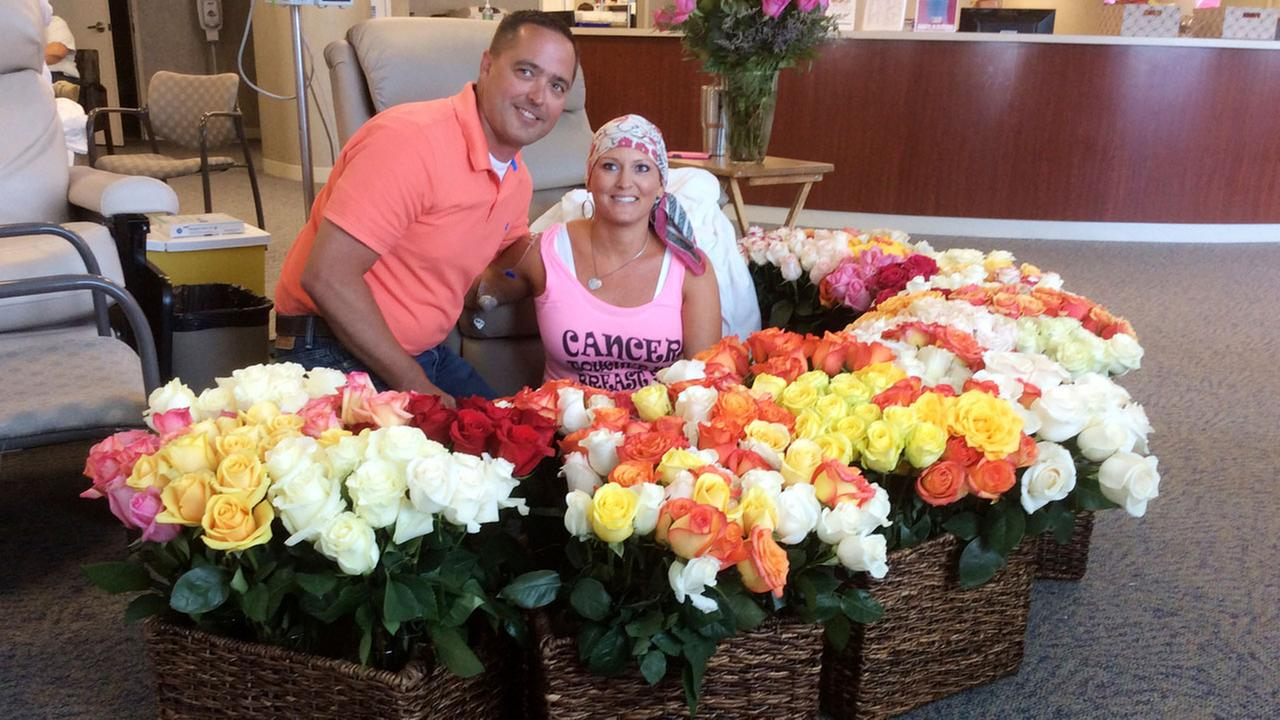 Brad and Alissa Bousquet  and the 500 roses he presented to her at the Methodist Estabrook Cancer Center in Omaha, Neb.