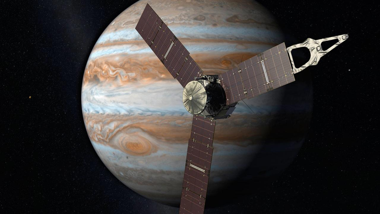 This artists rendering shows the Juno spacecraft above the planet Jupiter.