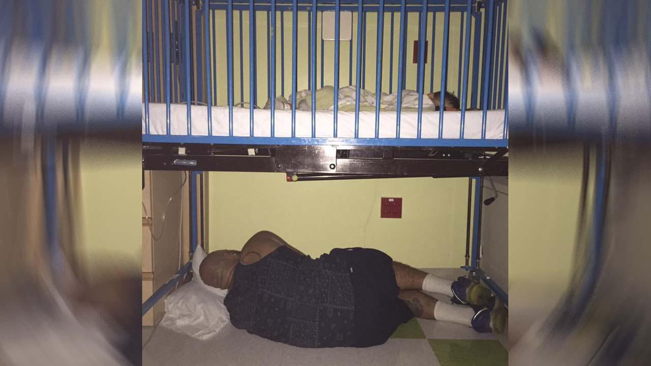 Photo of dad sleeping under son's hospital bed goes viral