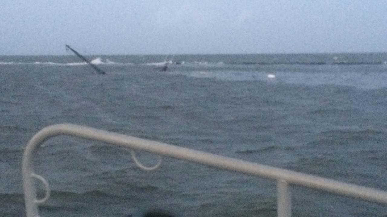 A Coast Guard boatcrew rescued three men after their 28-foot shrimp boat took on water and sank
