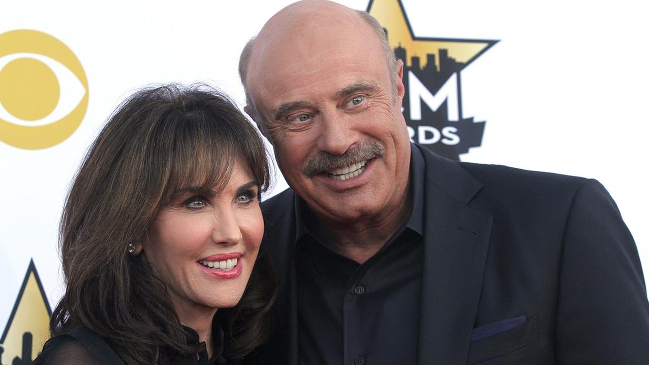 Robin McGraw, left, and Dr. Phil McGraw arrive at the 50th annual Academy of Country Music Awards at AT&T Stadium on Sunday, April 19, 2015.