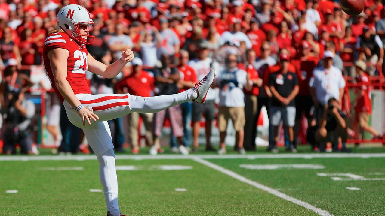 Nebraska punter Sam Foltz (27) punts during the first half of an NCAA college football game against Wisconsin in Lincoln, Neb., Saturday, Oct. 10, 2015.