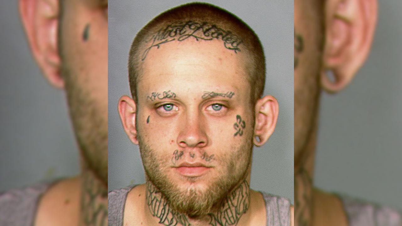 A judge has ordered a cosmetologist to cover Bayzle Morgans neck and facial tattoos that include a swastika and the words Most Wanted.