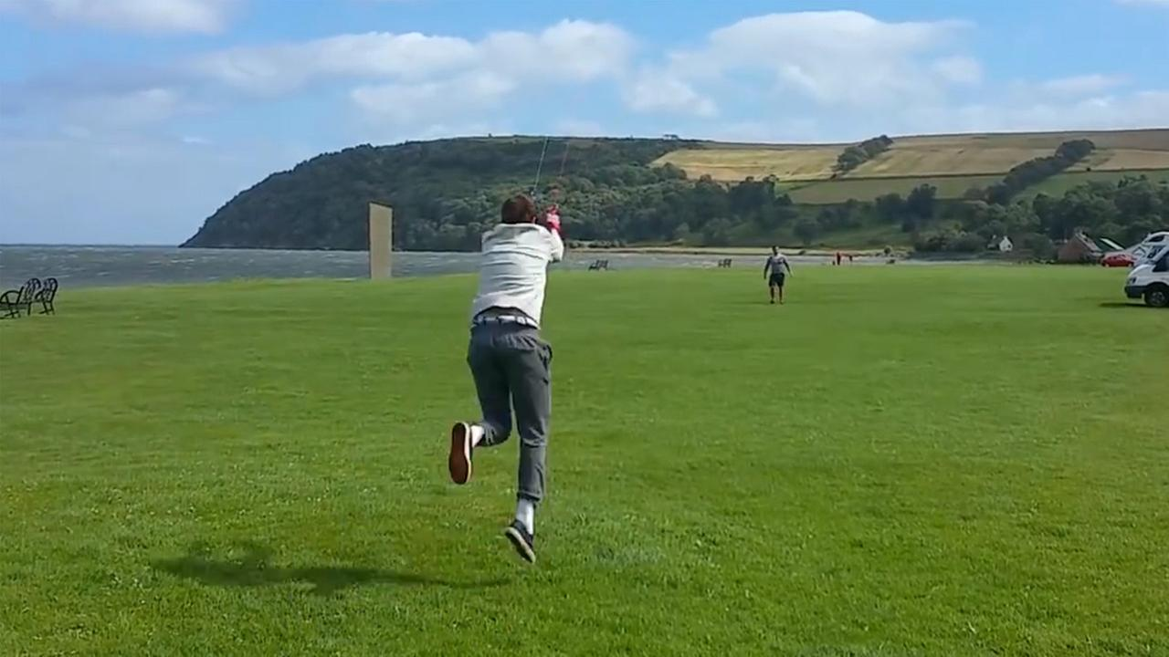 Unsuspecting man goes for ride on kite