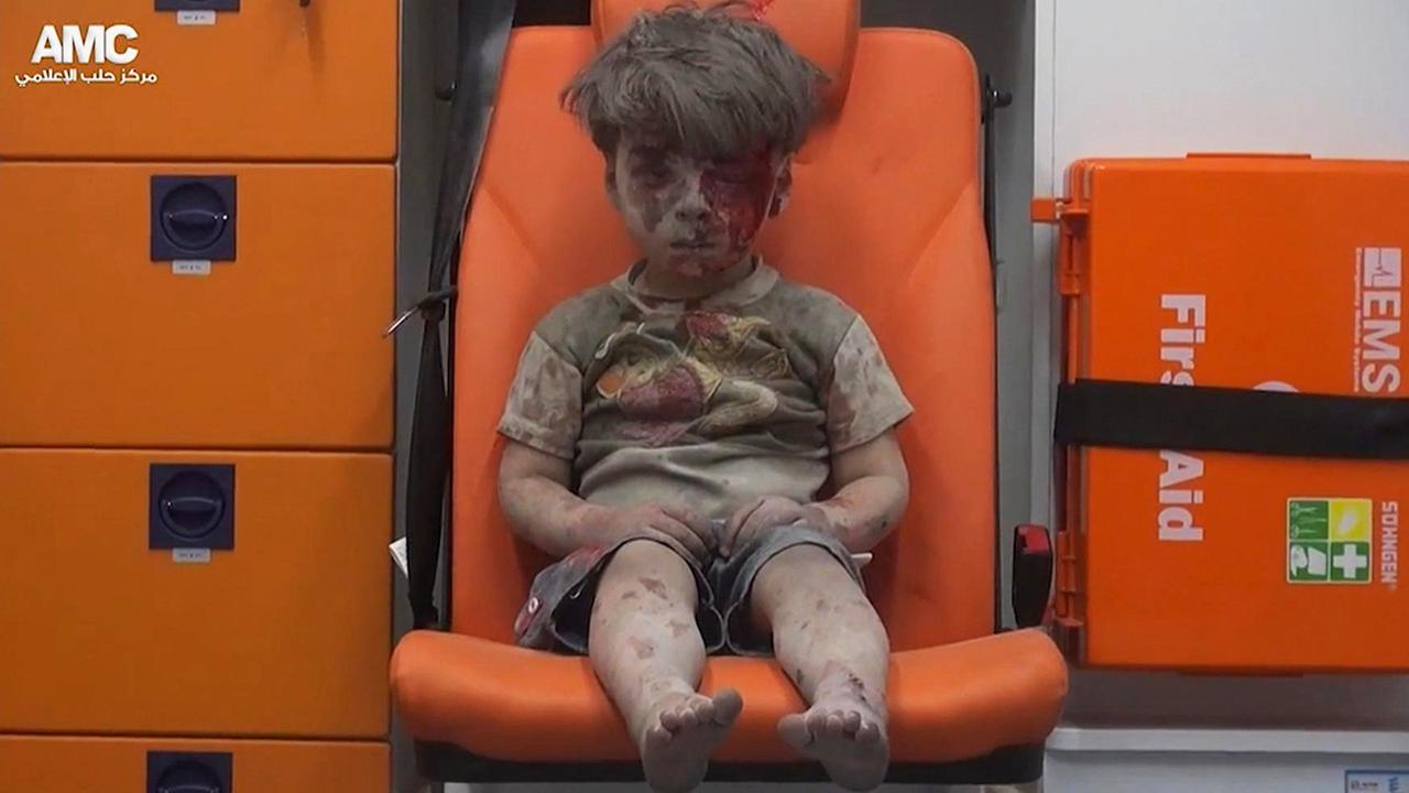 Aleppo - boy pulled from the rubble
