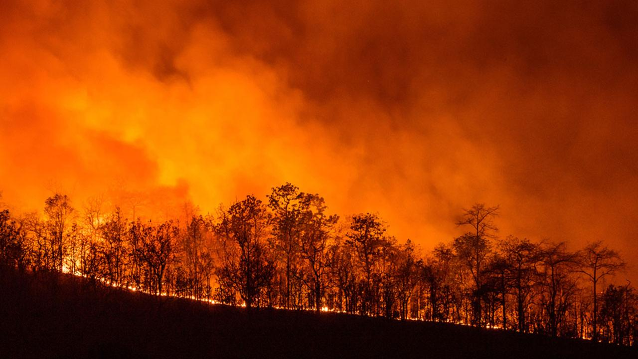 Officials: Woman driving on rim sparks California wildfires