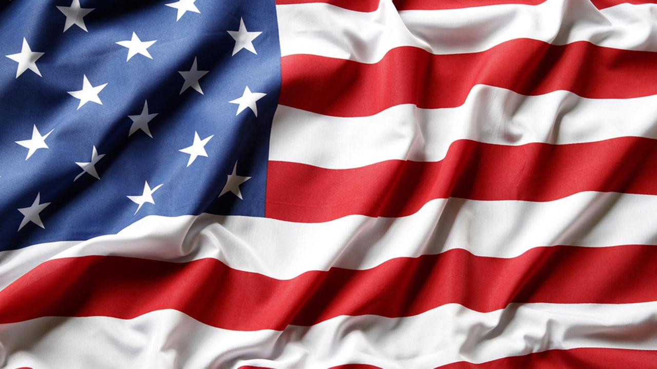 HS teacher who stepped on US flag faces 10 days unpaid leave