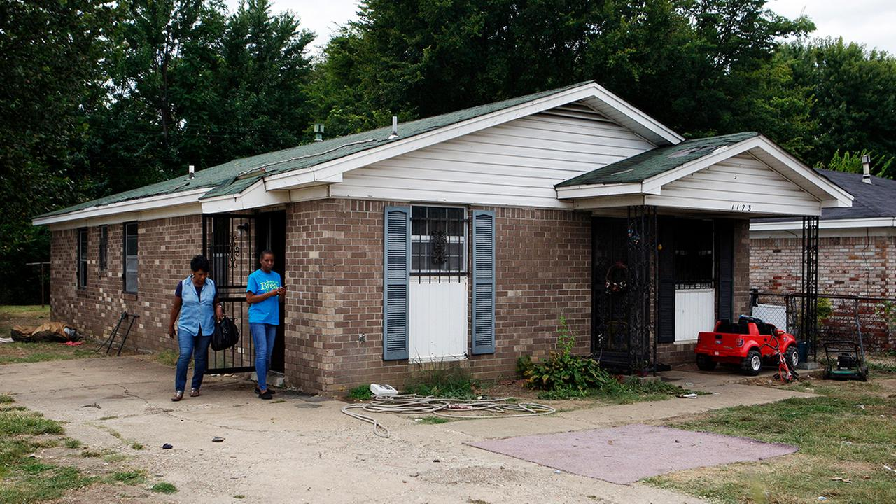 Pastor Mary Moore, left, and Janie Hendrix view a home where an early morning fire killed multiple people Monday, Sept. 12, 2016, in Memphis, TN