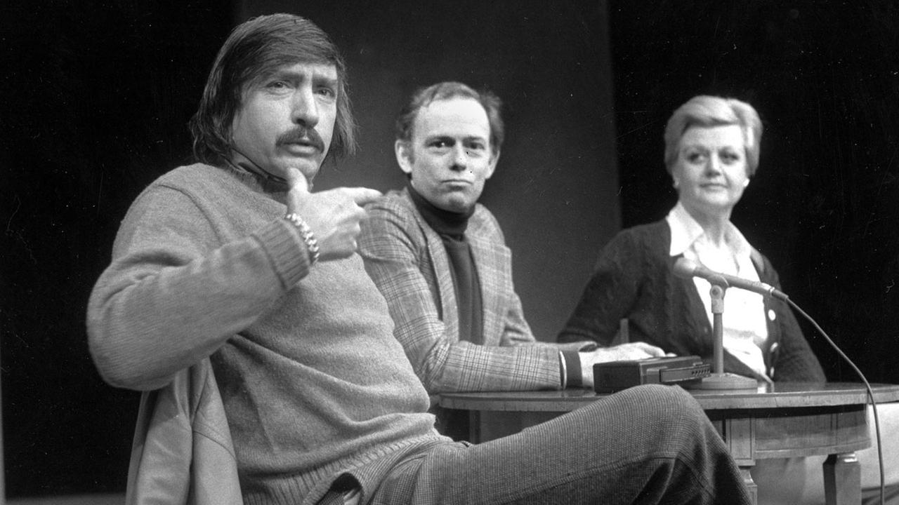 Playwright Edward Albee, left, makes a point as director Paul Weidner, center, and actress Angela Lansbury look on during a news conference in Hartford, Conn.